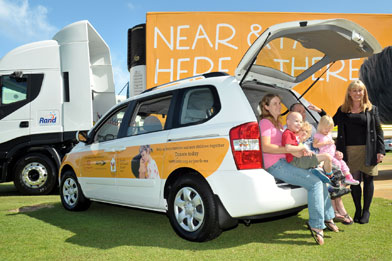 Kia Carnival donated by AHG and Rand trailer branding supporting the Ronald McDonald House Charity.